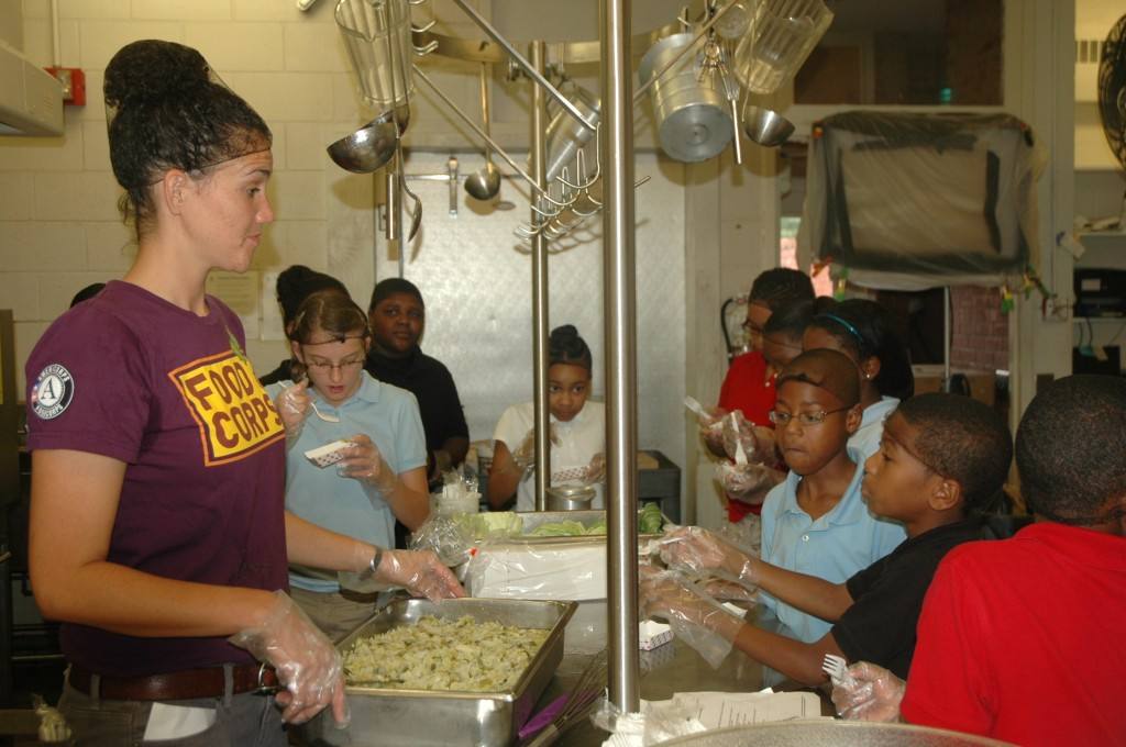 FoodCorps service member works with Warren County cafeteria staff to deliver cooking classes to students