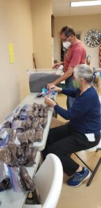 Volunteers working diligently on packing seed kits